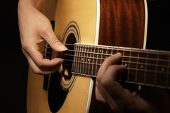 Man's hands playing acoustic guitar Royalty Free Stock Photos