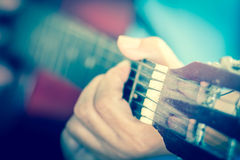 Man's hands playing acoustic guitar, close up, vintage and blurr Royalty Free Stock Image
