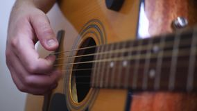 Man`s Hands Playing Acoustic Guitar. Concept for live music at festival on stage stock video