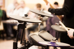 Man`s Hands playing drums Royalty Free Stock Photo