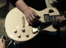 Man`s hands playing electric guitar Royalty Free Stock Photos