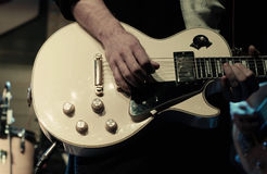 Man`s hands playing electric guitar Stock Photo