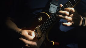 Man`s hands playing electric guitar stock video