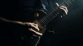Man`s hands playing electric guitar stock footage