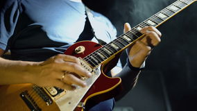 Man`s hands playing electric guitar, stock footage