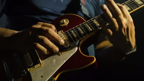 Man`s hands playing electric guitar, stock video footage