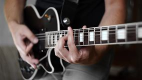 Man`s hands playing the funky rhythm on electric guitar, electric musical instruments, playing loud on the guitar, rock. Man`s hands playing the funky rhythm on stock video footage