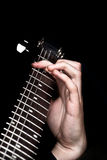 Man's hands playing guitar Royalty Free Stock Images