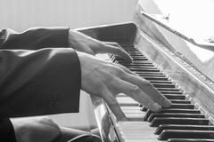 Man's hands playing the Piano. Royalty Free Stock Image