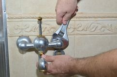 Removing old bathroom tap royalty free stock photography