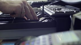 Man`s hands putting money in cash box Royalty Free Stock Photos