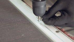 Man's hands screwing by screw gun screwdriver stock video footage