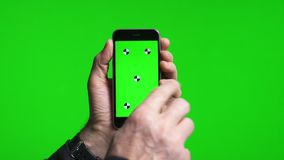 Man`s hands scrolling pages using phone with green screen stock video footage