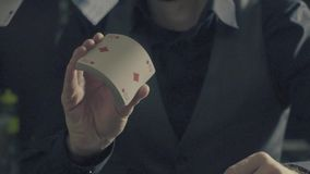 Man`s hands showing tricks with playing cards. Card tricks - Man`s hands showing tricks with playing cards. Close up, slow motion, HD stock video footage