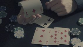 Man`s hands showing tricks with playing cards. Card tricks - Man`s hands showing tricks with playing cards. Close up, slow motion, HD stock video
