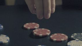 Man`s hands showing tricks with poker chips. Tricks - Man`s hands showing tricks with poker chips. Close up, slow motion, reverse, HD stock video