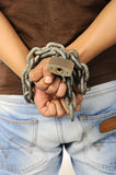 Man's Hands Tied With Chains Stock Photography