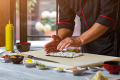 Man's hands touch white rice. Stock Images