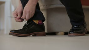 Man's hands tying shoes stock footage