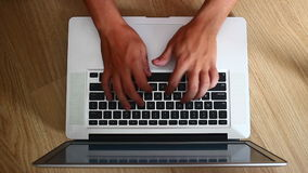Man's hands typing on a keyboard. On a laptop or notebook stock footage