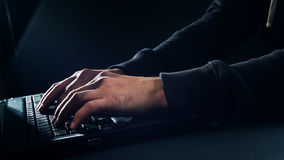 Man's hands typing on laptop keyboard concept Royalty Free Stock Photos