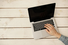 Man's hands typing on laptop keyboard Stock Photo