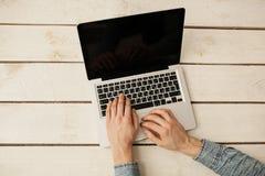 Man's hands typing on laptop keyboard Royalty Free Stock Photos