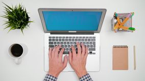 A Man`s Hands Typing on the Laptop royalty free stock image