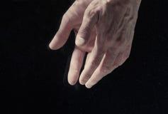 Man`s hands under water. On black background Stock Photo
