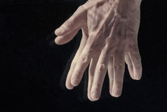 Man`s hands under water. On black background Royalty Free Stock Photo