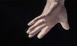 Man`s hands under water. On black background Royalty Free Stock Images