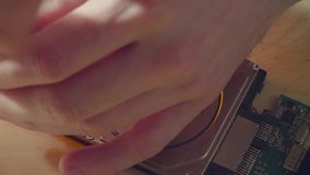 Man`s hands unscrewing the hdd cover. Macro shooting of man`s hands unscrewing the hard disk drive cover stock video footage