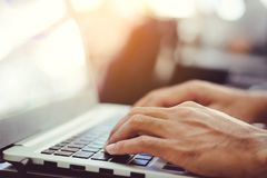 Man`s hands using laptop with copy space on blur royalty free stock photo