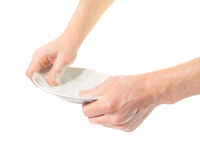 Man's hands washing dishes. On a white background Royalty Free Stock Photos