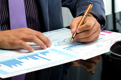 Man's hands working on business reports. At the office Royalty Free Stock Photos