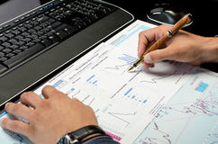 Man's hands working on business reports. At the office Royalty Free Stock Images