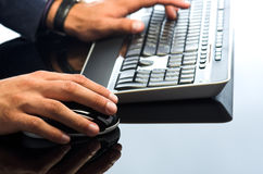 Man's hands working with computer mouse Stock Photography