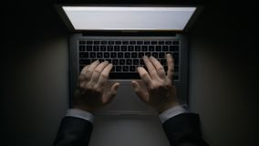 Man`s Hands Working on the Laptop at Night royalty free stock photos