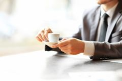 Man's hands working at a table Stock Images