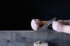 Man's hands working with wood Royalty Free Stock Photo