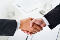 Man's handshake Stock Images