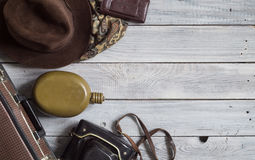 Man`s hat and retro accessories for travel on a white painted wo. Oden surface Stock Photography