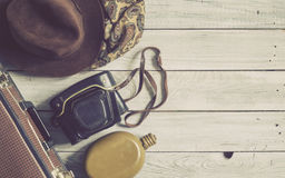 Man`s hat and retro accessories for travel on a white painted wo. Oden surface Royalty Free Stock Photo