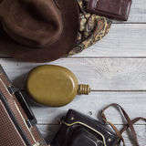 Man`s hat and retro accessories for travel on a white painted wo. Oden surface Stock Photo