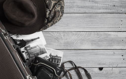 Man`s hat and retro accessories for travel on a white painted wo. Oden surface Royalty Free Stock Photos