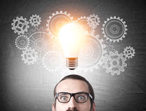Man`s head, cogs and light bulb Royalty Free Stock Image