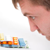 Man's head and colorful medicines Stock Photography