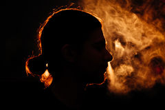 Man`s head in the smoke Royalty Free Stock Images