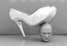 Man's head under a female heel Royalty Free Stock Images