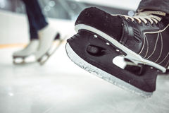 Man's hockey skates and women's figure skates on Royalty Free Stock Photography